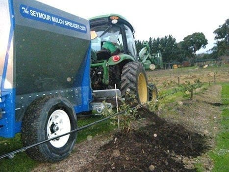 seymour spreader spreading mulch to assist with soil biota